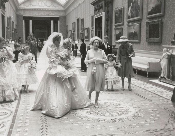 Princess Diana walks with Hambro and Queen Elizabeth.
