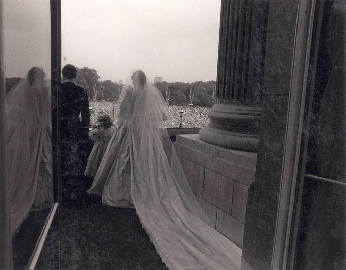 Prince Charles and Princess Diana are seen from behind as they stand on the balcony of Buckingham Palace.