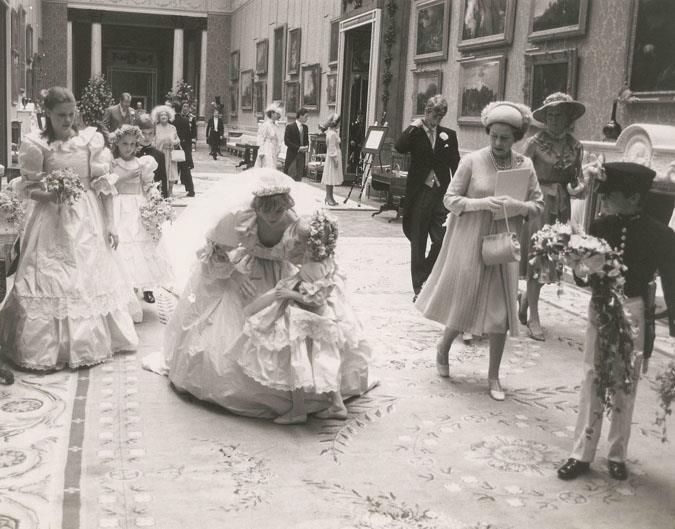 Diana sets Hambro down as Queen Elizabeth looks on.