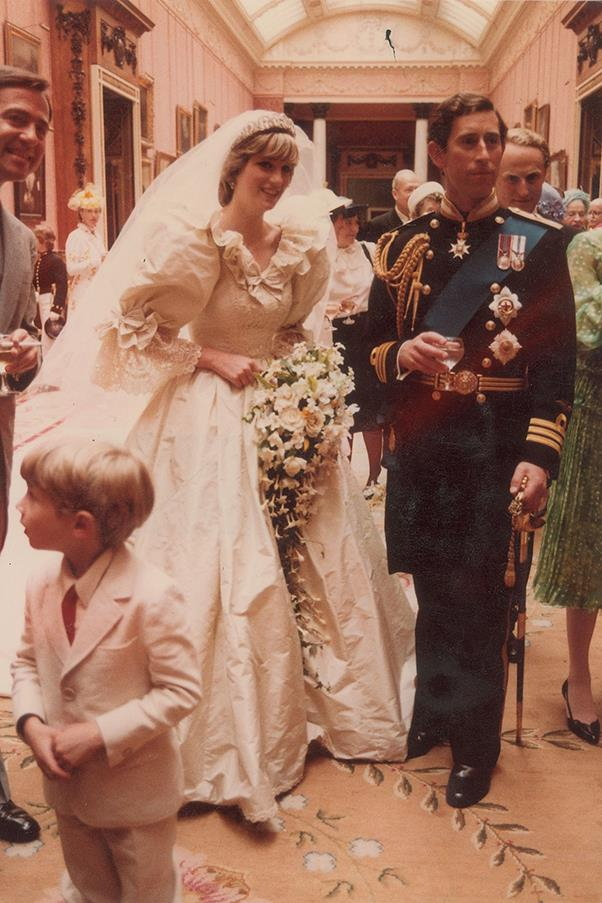 Princess Diana and Prince Charles stand together after their wedding.