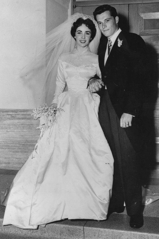 Elizabeth Taylor wore a dress by costume designer Helen Rose for her marriage to Conrad Nicky Hilton in 1950 (it was her first of eight).