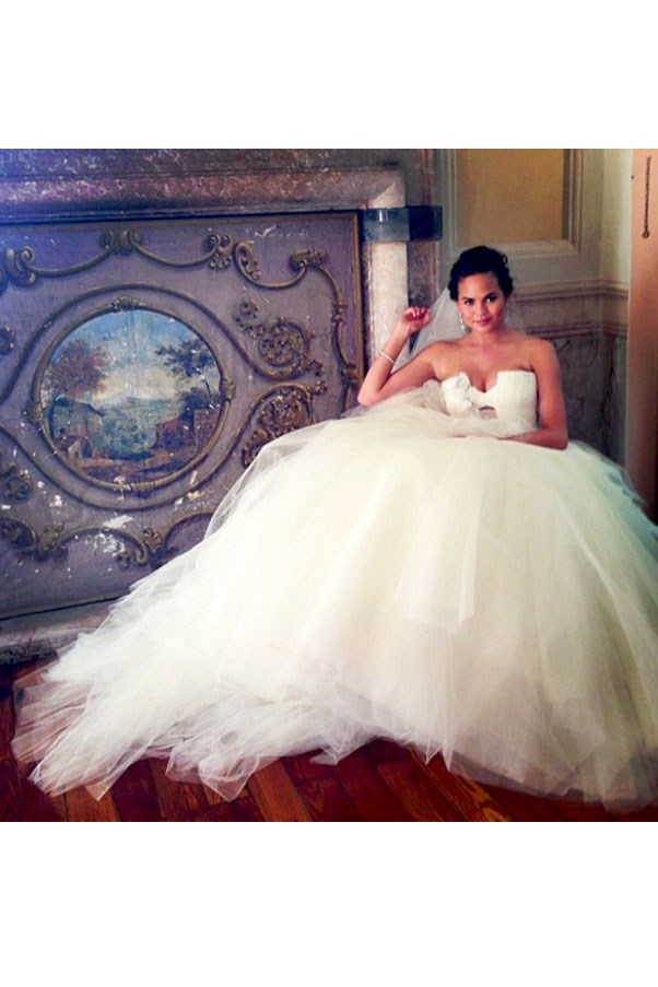 """Chrissy Teigen took to <a href=""""https://instagram.com/p/eSNNLcJjbH/"""">Instagram</a> to show off her Vera Wang gown when she married singer John Legend in Lake Como (he serenaded her with """"All of You"""" at the ceremony)."""