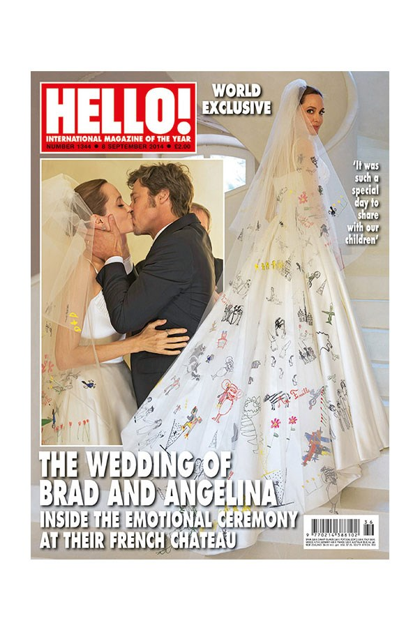 Angelina Jolie wore a Luigi Massi of Atelier Versace gown covered in artwork by her and Brad's children.