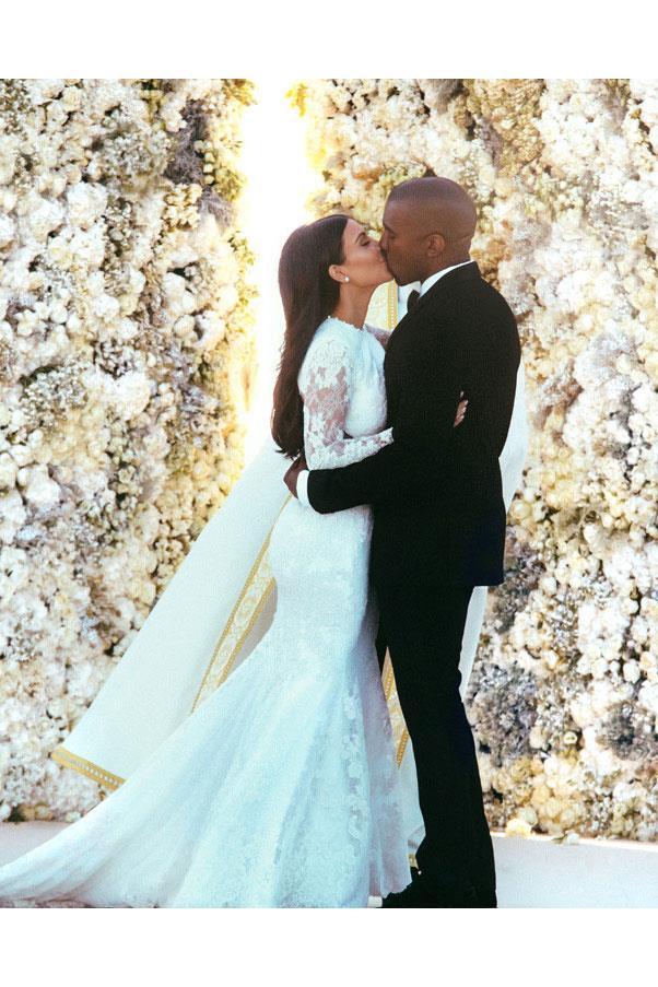 "<a href=""http://au.eonline.com/photos/12632/kim-kardashian-kanye-west-s-wedding-album"">Kim Kardashian</a> wore a Givenchy gown when she married Kanye West."