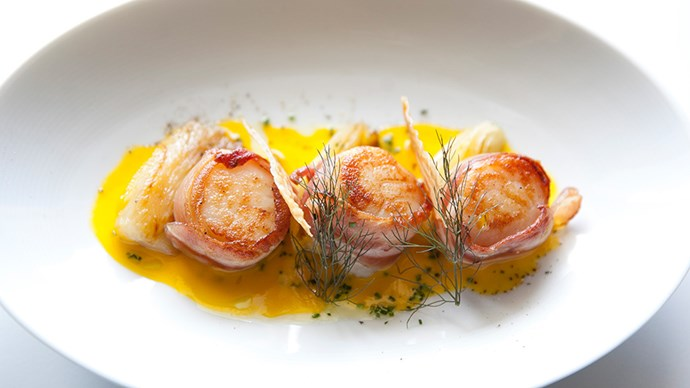 <strong>Must-Eat:</strong> <br><br> For entrée the house special of seared scallops wrapped in pancetta, served with pickled fennel, chives and saffron citronette is every bit as delicious as it sounds. Dinner is served in the formal dining room, and we'd recommend an earlier sitting so you can take full advantage of the floor-to-ceiling ocean view.