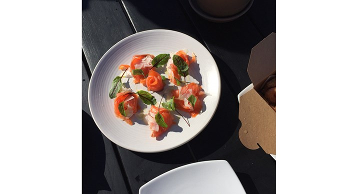 <strong>Must-Schedule:</strong> <br><br> A light lunch the day of departure. Set up on the sun deck, order something light off the bar menu (like the smoked trout, pictured) and drink in that view.