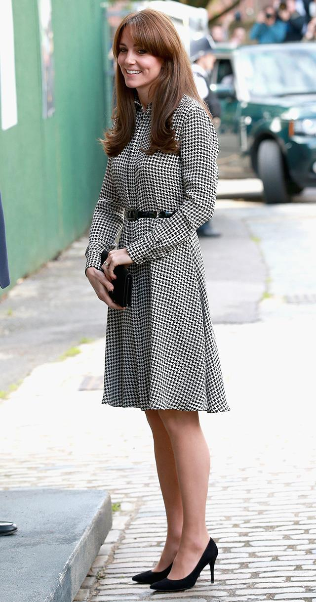 HRH donned the classic 'Austin' houndstooth dress by Ralph Lauren at the Anna Freud Centre in London. She teamed the chic shirt dress with a Mulberry bag and Stuart Weitzamn 'Power' pumps.