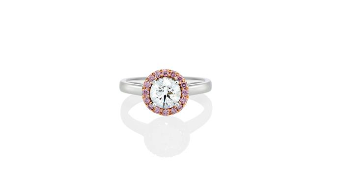 "<a href=""https://instagram.com/mondialpinkdiamonds/"">Mondial Pink Diamond Atelier</a> <br><br> Brilliant white diamond ring, surrounded by pink diamond halo. <br><br> Stockist: (02) 9267 7974"