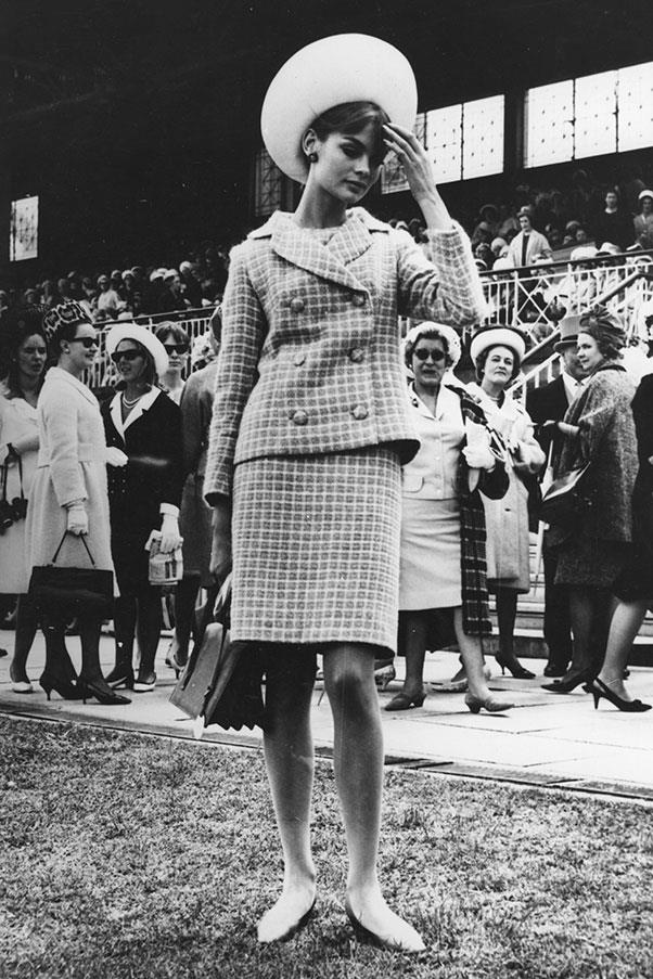 DuPont, the textile company that flew Shrimpton to Australia for racing season, hired Australian milliner Adele Chapeaux to create a hat for Shrimpton to wear to following racing events—she begrudgingly agreed.