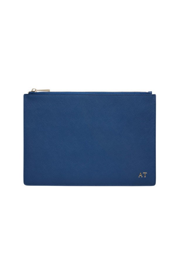 "<strong>3. A zip top purse:</strong> <br><br> Purse, $119.95, <a href=""http://thedailyedited.com/shop/large-navy-pouch/"">The Daily Edited</a>"