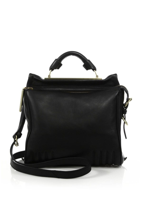 """<strong>4. A no-nonsense black carry-all:</strong> <br><br> Buy: 3.1 Phillip Lim bag, approx $1,357, at <a href=""""http://www.saksfifthavenue.com/main/ProductDetail.jsp?FOLDER%3C%3Efolder_id=2534374306623861&PRODUCT%3C%3Eprd_id=845524446758815&R=888824055600&P_name=3.1+Phillip+Lim&N=306623861+4294929607&bmUID=l0mSEZO"""">Saks Fifth Avenue</a>"""