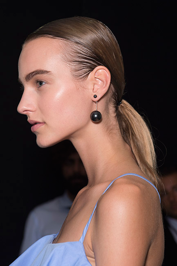 <strong>SALVATORE FARRAGAMO</strong><br><br> Full brows, barely there make-up and taupe eyeshadow made for a bright, glowy face.