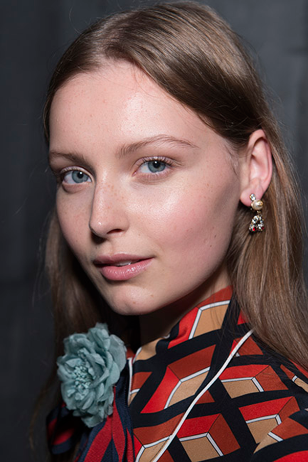 """<strong>GUCCI</strong><br><br> Make-up artist Pat McGrath used trace amounts of foundation, eye shadow, mascara, blush and lip balm, enhancing natural features to ensure the models were """"the best version of themselves."""" Understated make-up was accompanied by graceful waves, slicked back buns and loose braids."""