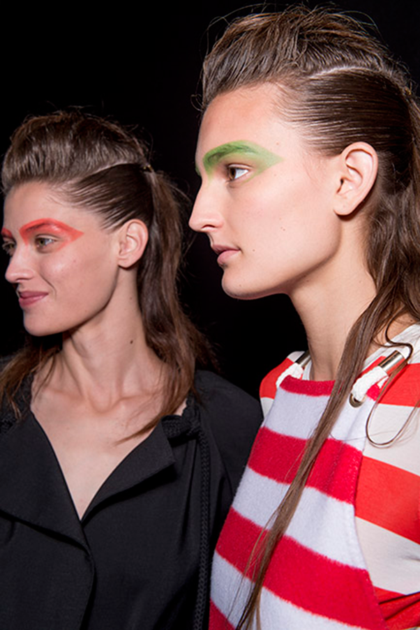 <strong>MAX MARA</strong><br><br> Clean skin, a subtle wash of colour on cheeks and lips, and brightly dyed green/red brows made this look edgy, without being too weird.