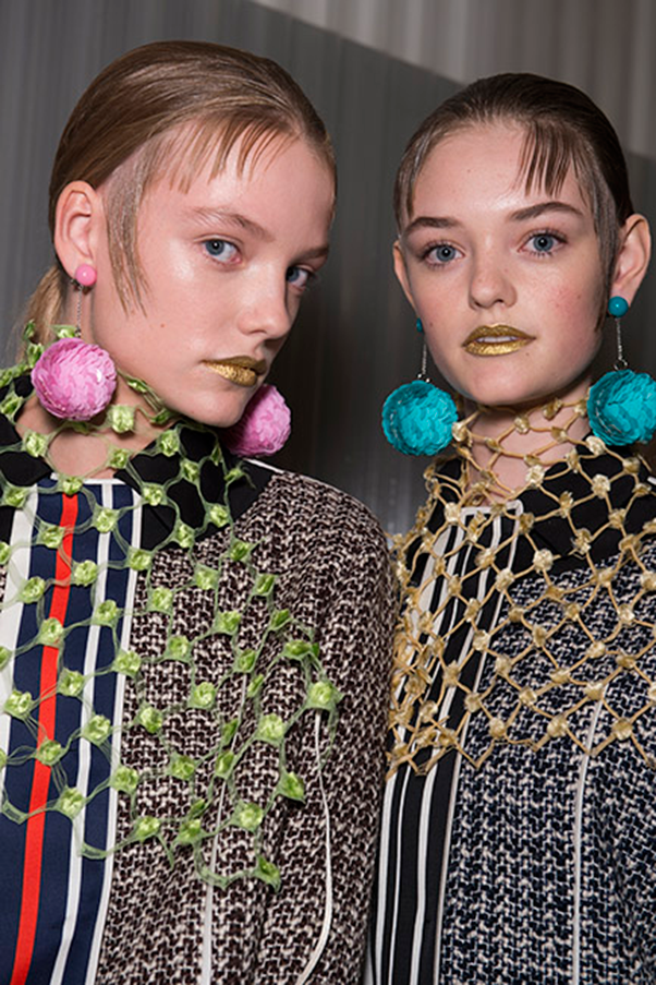 <strong>PRADA</strong><br><br> 'Conservative yet eccentric' was the winning formula at Prada, with minimal makup allowing the bold gold lips to really pop - without taking the look to crazy town.  Guido Palau slicked fringes and baby hairs onto foreheads to complete the look.