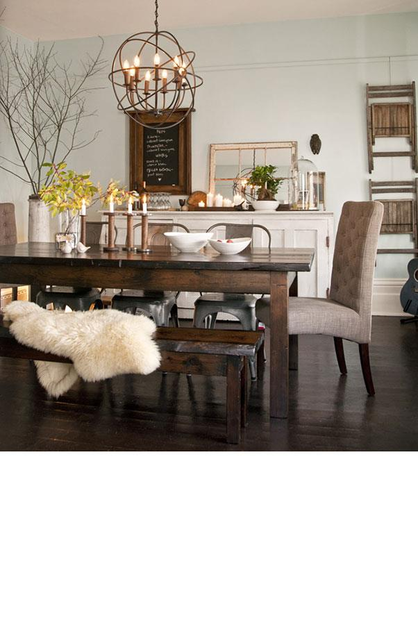"""<strong>THE DINING ROOM</strong><BR><BR> Warm accents and homey accessories make this welcoming dining room by <a href=""""http://tinbarnmarket.com/room-makeover-revealed/"""">Tin Barn Market</a> a favorite among Pinterest users.<BR><BR> Your formal living room will come at an equally formal price. The rustic farmhouse table alone will run you $1250. Then, take into account all the accessories – the sheepskin rug, candles, and pendant lighting. In total, you can expect to cough up about $4300."""