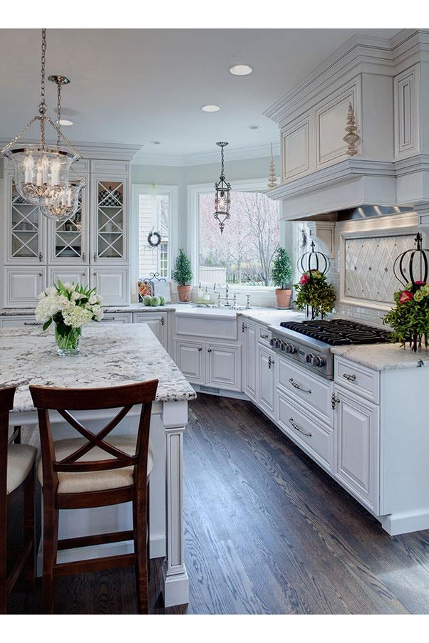 """<strong>THE KITCHEN</strong><BR><BR> Pinterest users adore this airy kitchen by <a href=""""http://www.drurydesigns.com/portfolio/well-dressed-traditional-glen-ellyn-kitchen"""">Drury Designs</a> for its pristine marble, white subway tiles, and abundance of fresh blooms. <BR><BR> With marble counters like that, let's just say you can expect to pay a small fortune."""