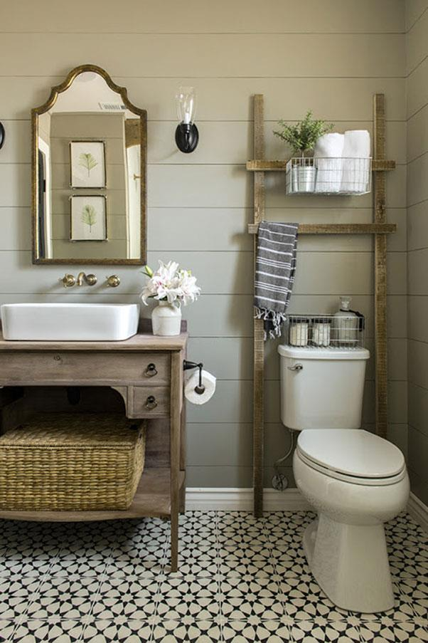 """<strong>THE BATHROOM</strong><br><br> This revamped bathroom by <a href=""""http://jennasuedesign.com/"""">Jenna Sue Design Co.</a> exudes modern farmhouse glamour, a favorite style among Pinterest users.<BR><BR> Here's where you can actually save a bit of money. E! pegs this bathroom look at a reasonable $600. Considering you already dropped $2.5 million on the house itself, we'd call this a big win."""