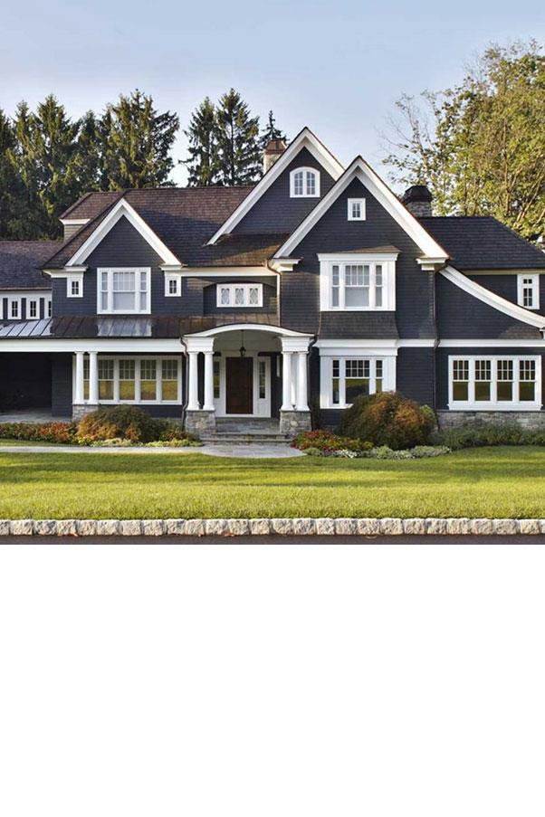 """<strong>THE EXTERIOR</strong><BR><BR> This stately slate-coloured home in the suburbs of Upstate New York, by <a href=""""http://degrawanddehaan.com/Residential-2/New-York-Suburbs/2"""">DeGraw & DeHaan Architects</a>, takes the cake when it comes to house exteriors.<BR><BR> What will it cost? $3.46 million (converted from $2.5 million US)"""