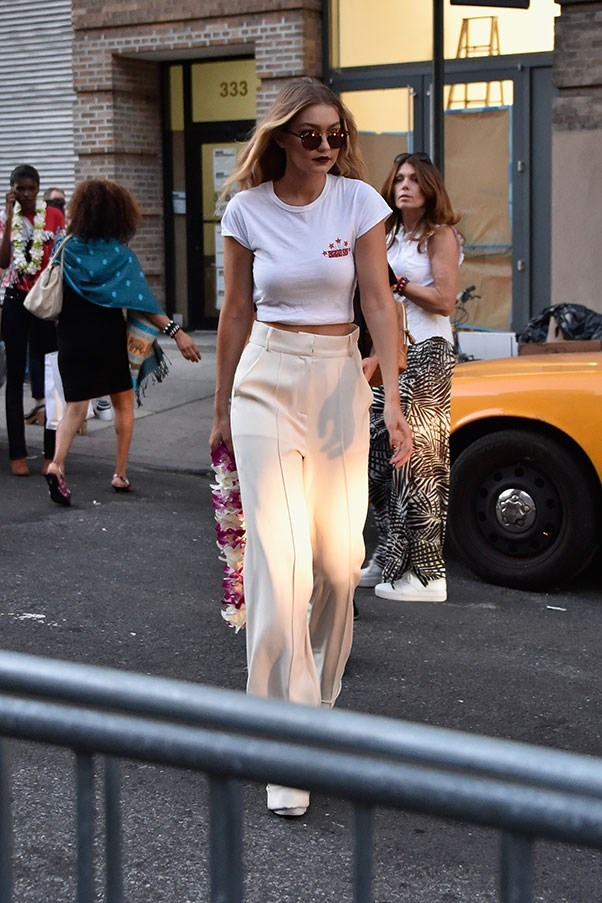 Gigi opts for a chic white on cream ensemble as she leaves the Anna Sui show at New York fashion week.