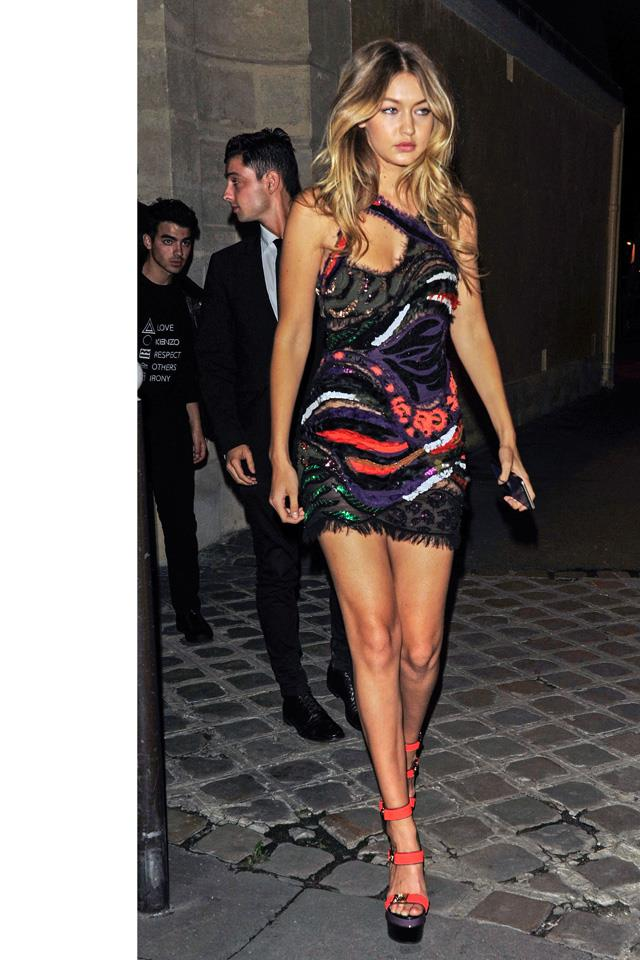 Gigi rocking a Versace dress while out partying during Paris Fashion Week.