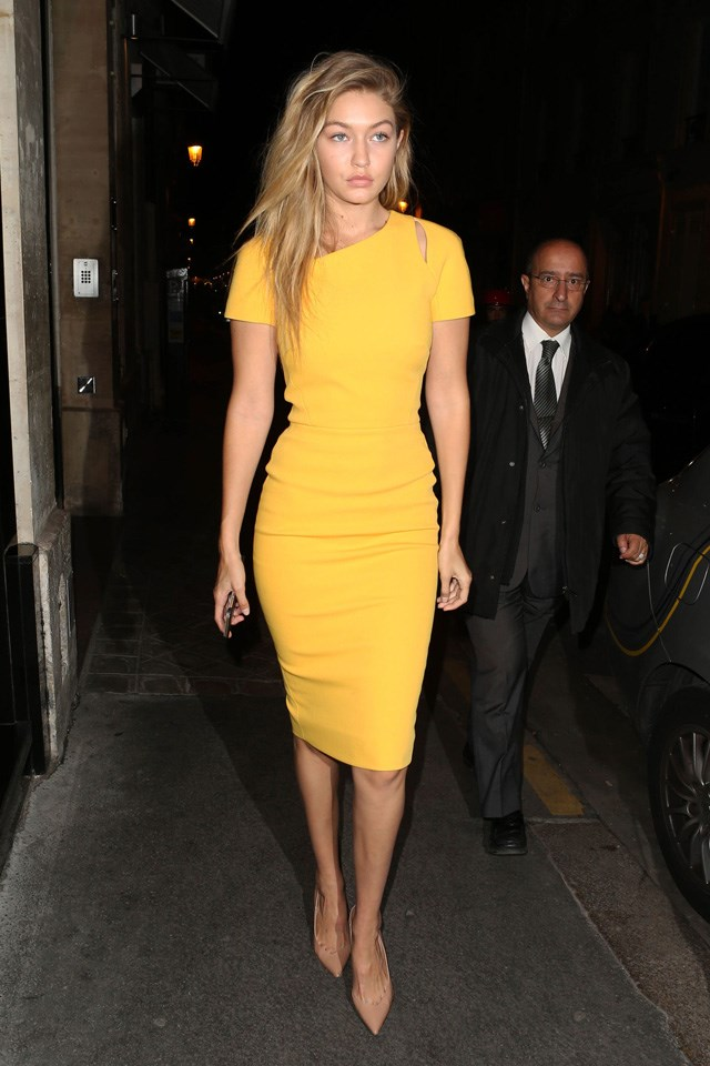 A yellow Victoria Beckham number and nude pumps, while dining in Paris.