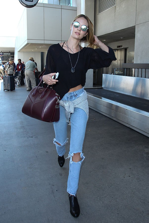 <strong>7. Ripped jeans</strong><br><br> Candice Swanepoel