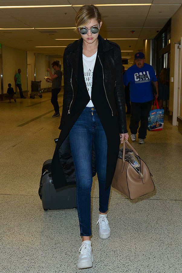<strong>8. White sneakers</strong><br><br> Gigi Hadid