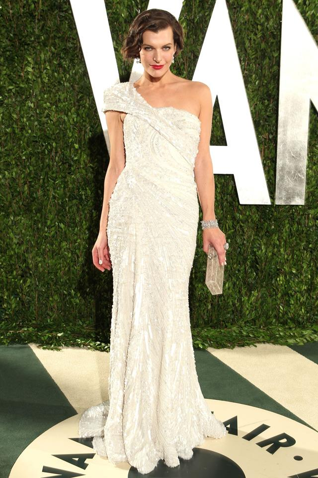 """2. Milla Jovovich in <a href=""""http://www.harpersbazaar.com.au/runway-report/the-shows/ready-to-wear/2015/10/elie-saab-ss16-rtw/"""">Elie Saab</a> at the 2012 Oscars."""