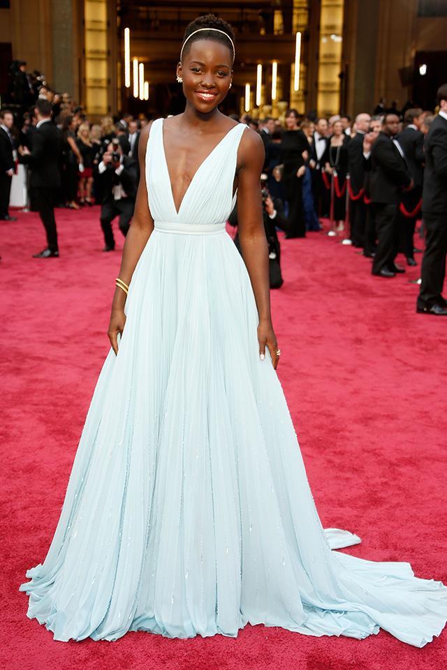 "8. Lupita Nyong'o in <a href=""http://www.harpersbazaar.com.au/runway-report/the-shows/ready-to-wear/2015/9/prada-ss16-fashion-week-show/"">Prada</a> at the Oscars."