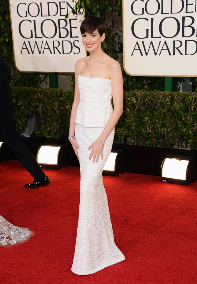 """11. Anne Hathaway in <a href=""""http://www.harpersbazaar.com.au/runway-report/the-shows/ready-to-wear/2015/10/chanel-rtw-2016/"""">Chanel</a> at the 2013 Golden Globes."""
