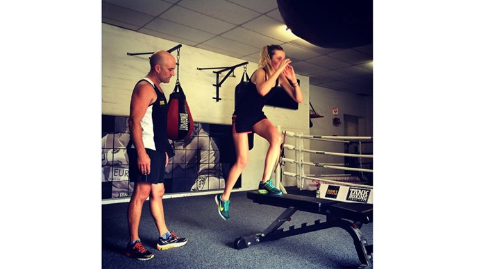"""<strong>3:00 pm</strong> <br><br> """"Boxing workout time. I train with Michael Olajide in NYC and we will do a HIT workout of boxing, jumping rope, and toning. I really love boxing – it is such a good calorie burner, and a brain workout too. It is hard for me to put on muscle, and it took a year of consistent workouts with Michael to get my arms to where they are now."""" <br><br> <a href=""""https://instagram.com/bridgetmalcolm/"""">@bridgetmalcolm </a>"""