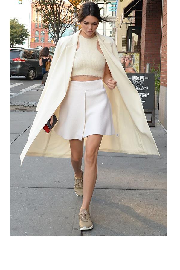 "<strong>Kylie, what is the one item in Kendall's wardrobe you'd like to 'borrow' permanently?</strong> <br><br> She has the best long trench coats that I might have ""borrowed"" in the past :)"