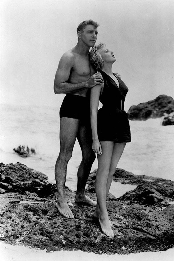 """<strong><em>From Here To Eternity</em>, 1953</strong> <br><br> Censors demanded that Deborah Kerr's haltertop swimsuit include a skirt so as not to be too provocative. But this modification didn't stop her beach scene with Burt Lancaster from becoming one of the most smoldering ever created for mainstream cinema, and it certainly didn't hinder her rise to fame. """"I don't think anyone knew I could act until I put on a bathing suit,"""" the leading lady once said. She went on to be nominated for the Oscar for best actress six times."""