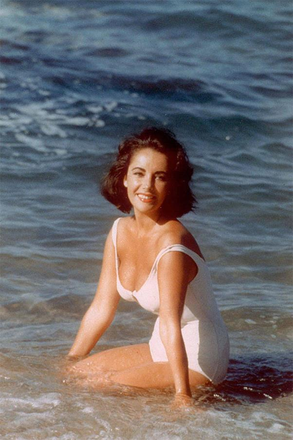 <strong><em>Suddenly, Last Summer</em>, 1959</strong> <br><br> In the film version of Tennessee Williams' dark play, Elizabeth Taylor's character Catherine Holly is asked by her cousin to wear an alluring white maillot in order to attract his would-be paramours. Taylor ended up succeeding both onscreen, and off, where the image of her in this one-piece still endures to this day.