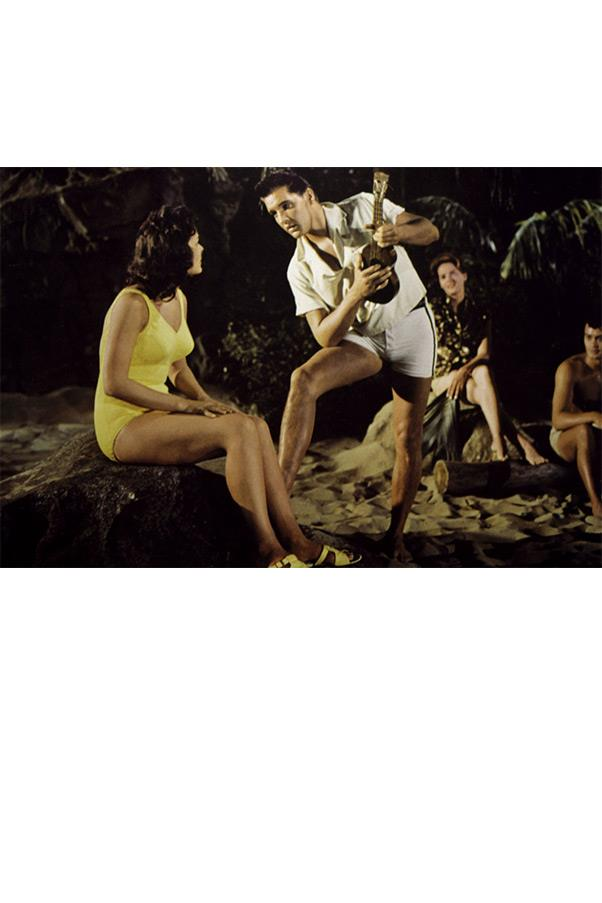 <strong><em>Blue Hawaii</em>, 1961</strong> <br><br> BLUE HAWAII, 1961 Legendary Hollywood costume designer Edith Head must have known most women would have trouble taking their eyes off of Elvis in this scene. The solution? A lemon yellow formfitting one-piece on costar Joan Blackman.