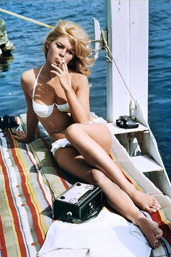 <strong><em>A Very Private Affair</em>, 1962</strong> <br><br> Brigitte Bardot is often credited with popularizing the bikini first by wearing the look in her 1952 film, The Girl in a Bikini, and then by wearing it a year later in Cannes, where paparazzi photographed her sunbathing in a strapless two-piece. But it is this white underwire top and ruffled bottom from Louis Malle's New Wave film that truly makes waves for us.