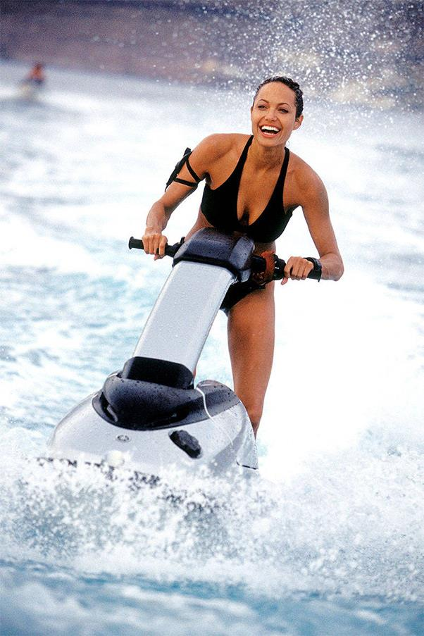 <strong><em>Lara Croft: Tomb Raider</em>, 2001</strong> <br><br> Not all bikinis are created alike, as Angelina Jolie proved in this poised-for-action black two-piece that was almost the perfect homage to Ursula Andress's swimsuit in Dr. No.