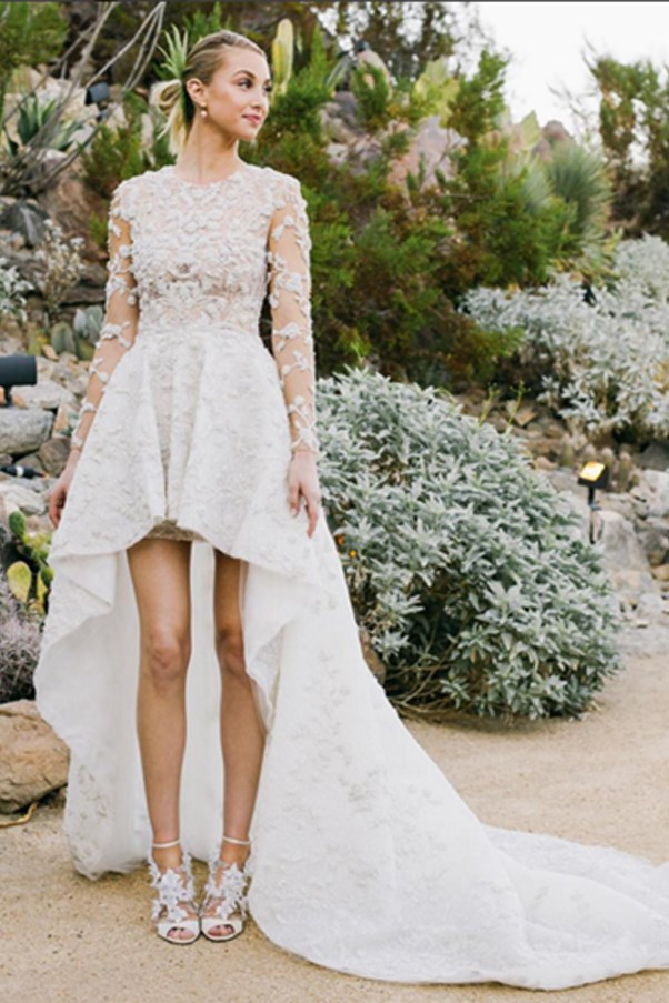 """Whitney Port married Tim Rosenman on Saturday, November 7 and opted for anything but a traditional wedding dress. <br><br> The stunning waterfall hemline lace dress was designed in collaboration with Ashi Studio. <br><br> Port shared her wedding album with US Weekly, get more details <a href=""""http://www.usmagazine.com/celebrity-style/news/whitney-port-waterfall-hemline-wedding-dress-bride-picture-20151111"""">here</a>."""
