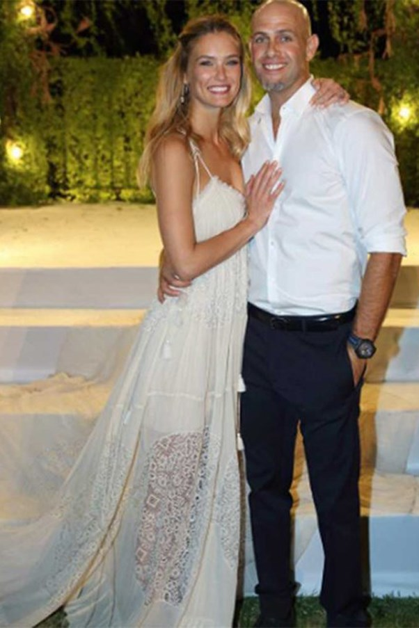 Bar Refaeli, the former Victoria's Secret model, looks beautiful in her sheer lace, laser-cut Chloé dress as she married Adi Ezra in her home country of Israel.