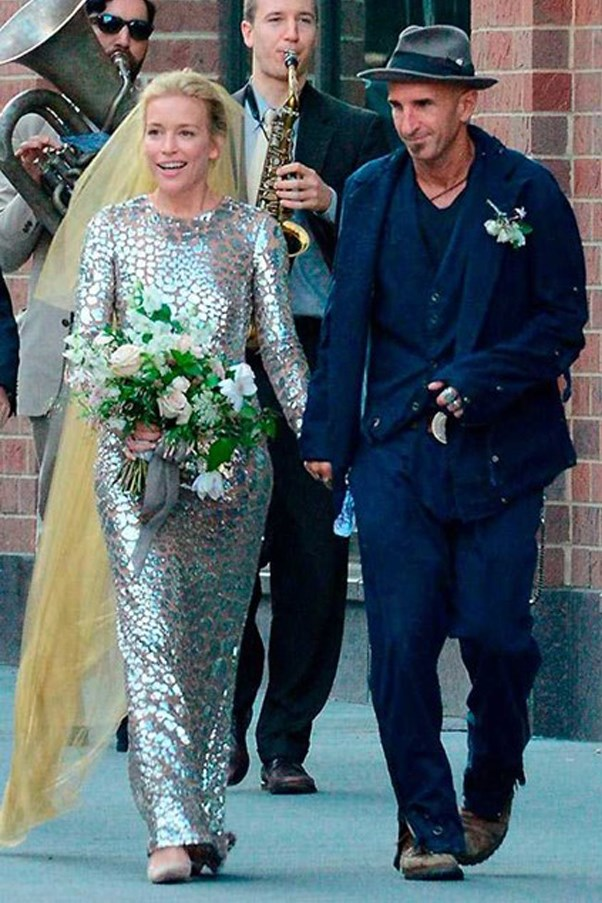 Piper Perabo (remember Coyote Ugly?) married her long term boyfriend Stephen Kay wearing a metallic, animal-print dress by Michael Kors.