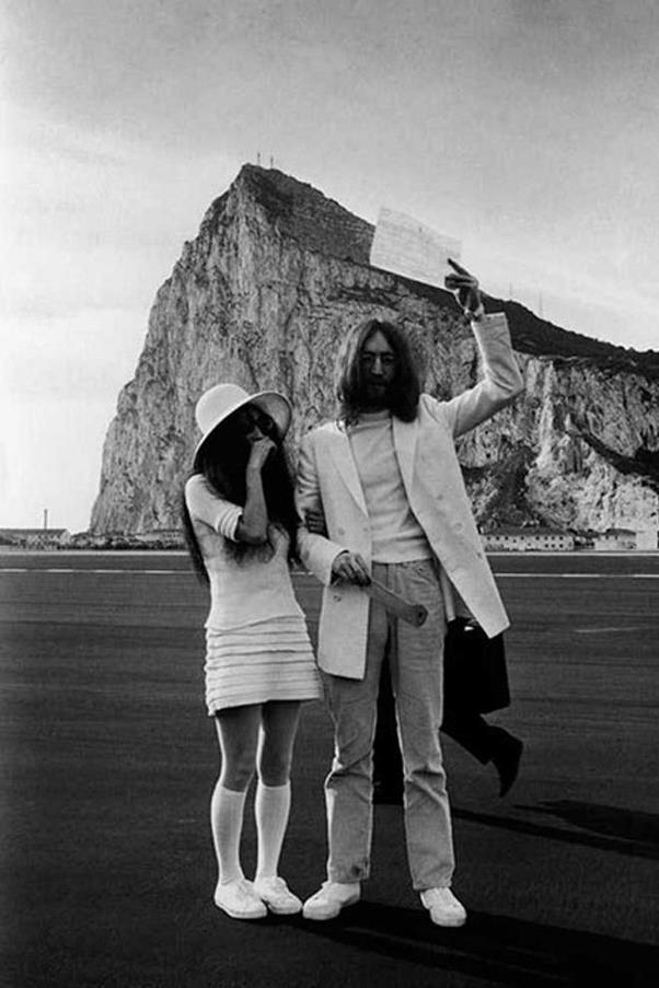 Who would've thought that a textured mini dress, knee-high socks and trainers could work for a ceremony? Yoko Ono did.