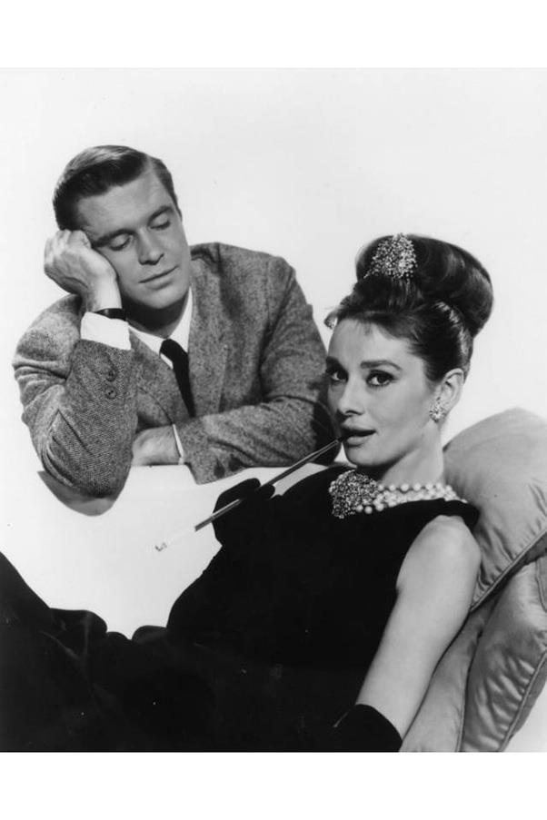 <strong>7. BREAKFAST AT TIFFANY'S (1961)</strong><br><br> Audrey Hepburn was immortalised as Holly Golightly, the gold-digging socialite who falls in love with her poor, struggling writer neighbour and, somwhere in the process, became a style/cultural icon for the next fifty years.