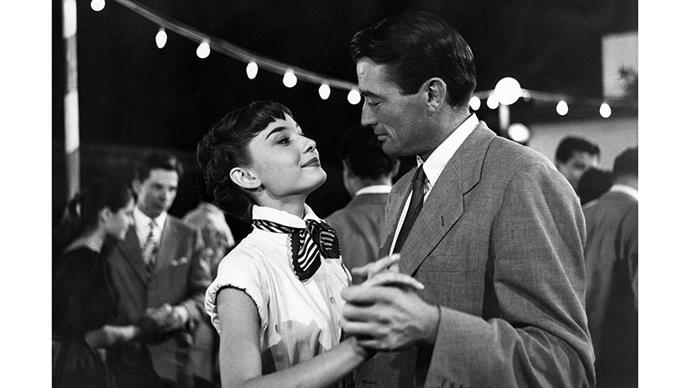 <strong>35. ROMAN HOLIDAY (1953)</strong><br><br> Audrey Hepburn makes yet <em>another</em> appearance on our list as a Vespa-riding European princess who falls in love with an American reporter.