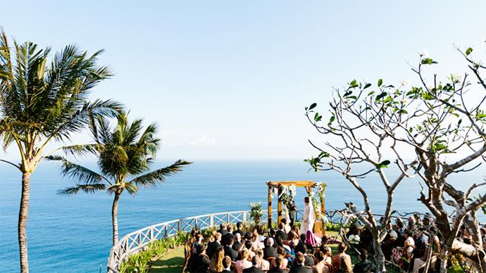 """<strong>On the location:</strong> <br><br> Both the ceremony and reception were at <a href=""""http://www.khayanganestate.com/"""">Khayangan Estate</a> in Uluwatu, Bali. We kept this a secret from everyone. We asked our guests to meet at <a href=""""http://www.wretreatbali.com/"""">The W Hotel</a> in Seminyak and arranged cars to pick them up and transport them to Uluwatu. It created such a buzz! Even the drivers were briefed to keep it a secret. The view when you walk into Khayangan is absolutely magnificent so it really set the scene for the rest of the day."""