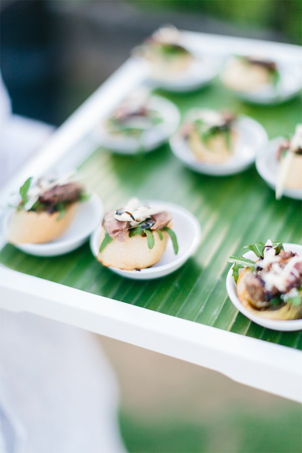 """<strong>On the food:</strong> <br><br> Our caterer was <a href=""""http://www.mnm-concepts.com/"""">M&M Catering</a>. Guests were greeted with a cool towel and welcome drink. After the ceremony we served cocktails and canapes in the mezzanine garden. A sit down dinner followed with full open bar. Rabb wanted to have a whisky and cigar lounge which everyone loved! We flew to Bali a month before the wedding and carefully chose all the drinks and all the food that was served on every day. It was a fun pre-wedding holiday! At the wedding for entree we had duck or lobster and for main we had beef fillet or barramundi."""