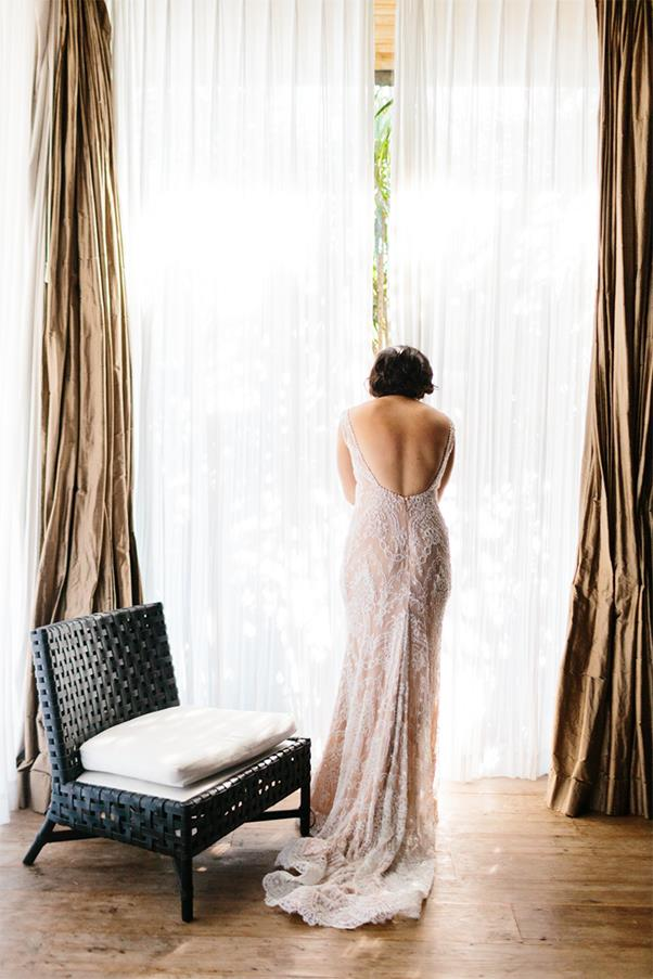 <strong>On the perfect dress:</strong> <br><br> I knew what I wanted and I knew I wanted Steven Khalil to make it. I had always wanted lace, long sleeves and backless. I thought I wouldn't be able to have long sleeves in Bali but at our first meeting he suggested a removable bolero. It was perfect. Two dresses in one.