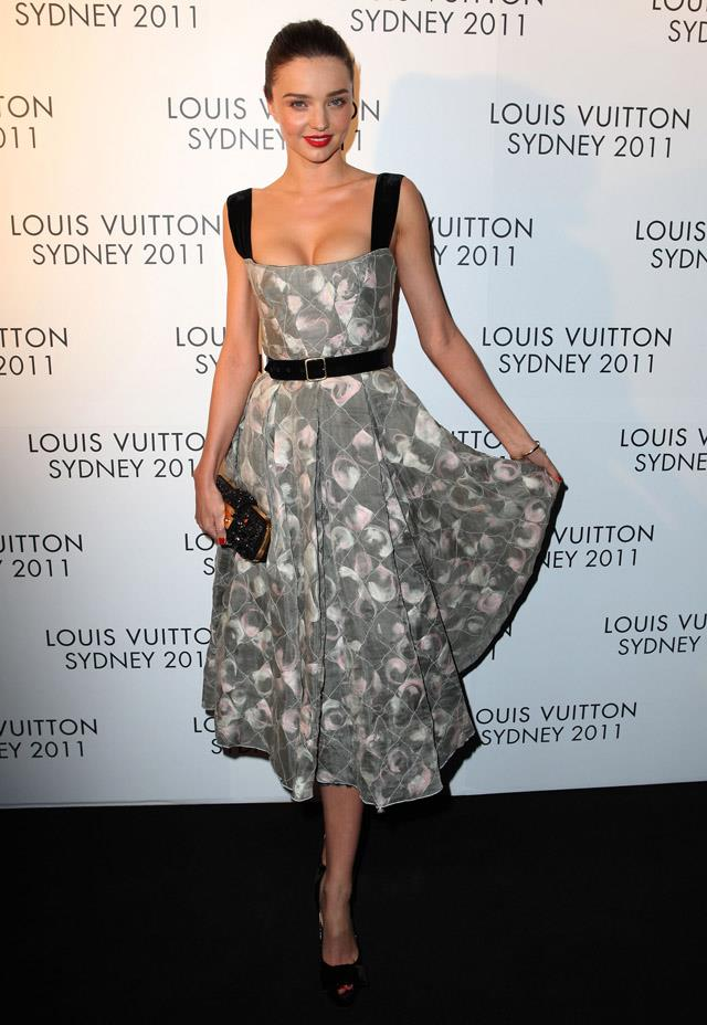 <strong>December 2, 2011</strong><br><Br> Miranda returned to Australia purely to attend the opening of the Louis Vuitton Maison in Sydney - at which she wore a Louis Vuitton creation, naturally.