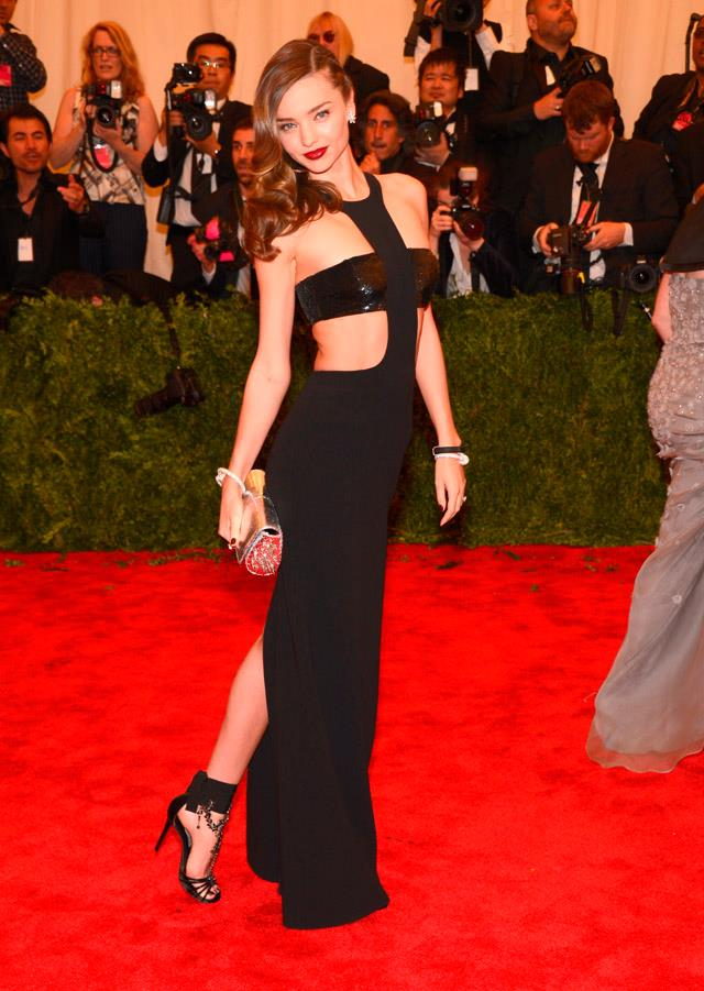 """<strong>May 6, 2013</strong><br><br> Miranda wore a cut-out Michael Kors number to the 2013 Met Gala, themed """"PUNK: Chaos to Couture""""."""