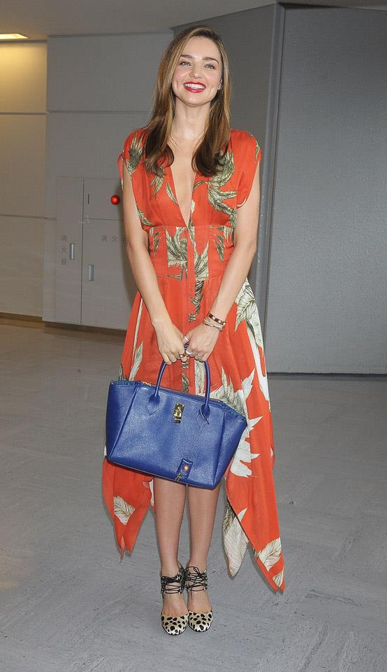 <strong>July 18, 2013</strong><br><br> Miranda looks fresh as ever stepping off the plane at Narita international airport in Tokyo.